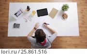 Купить «woman with papers and calculator at home office», видеоролик № 25861516, снято 23 марта 2017 г. (c) Syda Productions / Фотобанк Лори
