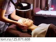 Купить «beautician doing face massage to woman at spa», фото № 25871608, снято 26 января 2017 г. (c) Syda Productions / Фотобанк Лори