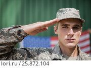 Купить «Portrait of military soldier giving salute», фото № 25872104, снято 24 ноября 2016 г. (c) Wavebreak Media / Фотобанк Лори