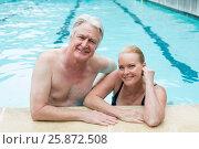 Купить «Couple leaning at poolside», фото № 25872508, снято 12 декабря 2016 г. (c) Wavebreak Media / Фотобанк Лори