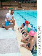 Купить «Instructor assisting senior swimmers at poolside», фото № 25872940, снято 12 декабря 2016 г. (c) Wavebreak Media / Фотобанк Лори
