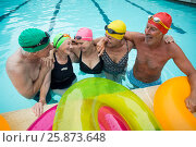 Купить «Happy senior swimmers enjoying in pool», фото № 25873648, снято 12 декабря 2016 г. (c) Wavebreak Media / Фотобанк Лори