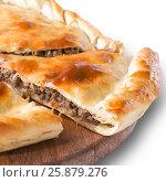 Купить «Ossetian pie with meat isolated on white», фото № 25879276, снято 18 июля 2018 г. (c) Ольга Сергеева / Фотобанк Лори