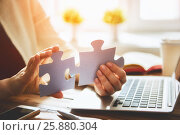 Купить «Woman connects couple puzzle piece», фото № 25880304, снято 12 марта 2017 г. (c) Константин Юганов / Фотобанк Лори