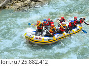 Купить «ARKHYZ, RUSSIA - MAY 10, 2014: Tourists who rafting on the Zelenchuk river», фото № 25882412, снято 10 мая 2014 г. (c) Ирина Кучугурина / Фотобанк Лори