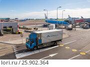 Купить «A Truck driving on the airport territory», фото № 25902364, снято 9 октября 2016 г. (c) Донцов Евгений Викторович / Фотобанк Лори