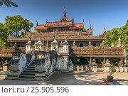 Купить «Shwenandaw Kyaung Temple or Golden Palace Monastery in Mandalay, Myanmar», фото № 25905596, снято 29 мая 2020 г. (c) BE&W Photo / Фотобанк Лори
