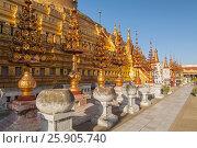 Купить «The Shwezigon Pagoda, the famous chedi in Bagan, Myanmar», фото № 25905740, снято 26 августа 2019 г. (c) BE&W Photo / Фотобанк Лори