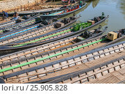 Купить «Boats waiting for tourists, Nyaung Shwe, Inle lake, Shan state, Myanmar», фото № 25905828, снято 16 января 2019 г. (c) BE&W Photo / Фотобанк Лори