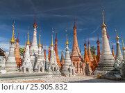 Купить «Buddhist stupas of Shwe Inn Thein Paya, pagoda complex, Inthein, Indein, Shan State, Myanmar», фото № 25905832, снято 26 марта 2019 г. (c) BE&W Photo / Фотобанк Лори