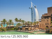 "Купить «View of the world's first seven stars luxury hotel Burj Al Arab ""Tower of the Arabs"", Madinat Jumeirah in Dubai with palms tree, United Arab Emirates», фото № 25905960, снято 19 ноября 2018 г. (c) BE&W Photo / Фотобанк Лори"