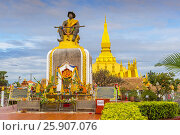 Купить «Statue of King Setthathirat with Pha That Luang in the background, Vientiane, Laos, Indochina, Southeast Asia», фото № 25907076, снято 27 мая 2019 г. (c) BE&W Photo / Фотобанк Лори