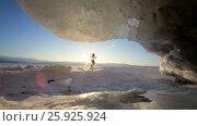 Купить «Путешественник идет по льду озера Зимой. Озеро Байкал», видеоролик № 25925924, снято 12 марта 2017 г. (c) Виталий Зверев / Фотобанк Лори