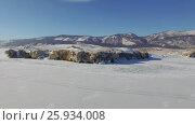 Купить «Аэросъемка с воздуха. Зима. Озеро Байкал», видеоролик № 25934008, снято 12 февраля 2017 г. (c) Виталий Зверев / Фотобанк Лори