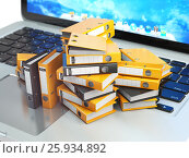 Laptop and pile of file cabinet with ring binders. Database, archive, computer data storage, office paperwork and electronic document management concept. Стоковое фото, фотограф Maksym Yemelyanov / Фотобанк Лори