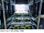 Купить «IT Engineer installs JBOD to rack in datacenter», фото № 25936748, снято 7 июля 2020 г. (c) Mikhail Starodubov / Фотобанк Лори