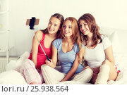 Купить «teen girls with smartphone taking selfie at home», фото № 25938564, снято 14 ноября 2015 г. (c) Syda Productions / Фотобанк Лори