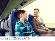 Купить «happy family riding in travel bus», фото № 25938616, снято 21 октября 2015 г. (c) Syda Productions / Фотобанк Лори