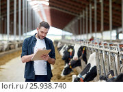 Купить «farmer with clipboard and cows in cowshed on farm», фото № 25938740, снято 12 августа 2016 г. (c) Syda Productions / Фотобанк Лори