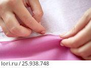 Купить «woman with pins stitching paper pattern to fabric», фото № 25938748, снято 29 сентября 2016 г. (c) Syda Productions / Фотобанк Лори