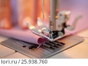 Купить «sewing machine presser foot stitching fabric», фото № 25938760, снято 29 сентября 2016 г. (c) Syda Productions / Фотобанк Лори