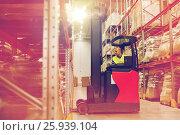 Купить «man on forklift loading cargo at warehouse», фото № 25939104, снято 9 декабря 2015 г. (c) Syda Productions / Фотобанк Лори