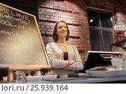 Купить «happy woman or barmaid at cafe counter», фото № 25939164, снято 17 ноября 2016 г. (c) Syda Productions / Фотобанк Лори