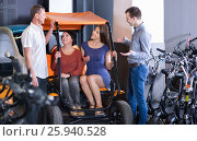Купить «Male employee helping family to select tour electrics», фото № 25940528, снято 16 октября 2018 г. (c) Яков Филимонов / Фотобанк Лори