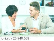 Купить «Mother and son with smartphones», фото № 25940668, снято 8 июля 2020 г. (c) Яков Филимонов / Фотобанк Лори