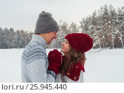 Купить «Happy Young Couple in love embracing in Winter Park face to face close to each other», фото № 25945440, снято 16 марта 2019 г. (c) Сергей Дорошенко / Фотобанк Лори