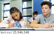 Купить «Schoolboy cheating during exam in classroom», видеоролик № 25946548, снято 25 июня 2019 г. (c) Wavebreak Media / Фотобанк Лори