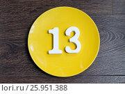 Купить «The number thirteen on the yellow plate», фото № 25951388, снято 23 марта 2017 г. (c) Григорий Алехин / Фотобанк Лори