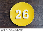 Купить «Figure twenty-six on the yellow plate», фото № 25951404, снято 23 марта 2017 г. (c) Григорий Алехин / Фотобанк Лори
