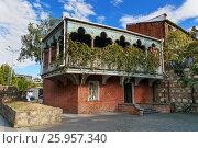 Купить «House with carved wooden balcony in Tbilisi Georgia», фото № 25957340, снято 25 сентября 2016 г. (c) Elena Odareeva / Фотобанк Лори