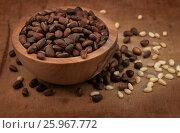 Купить «Wooden bowl of pine nuts», фото № 25967772, снято 20 февраля 2017 г. (c) Антон Стариков / Фотобанк Лори