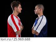 Купить «Two rival football player looking at each other», фото № 25969688, снято 19 октября 2016 г. (c) Wavebreak Media / Фотобанк Лори