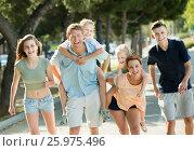 Купить «Young parents with kids taking fast promenade», фото № 25975496, снято 16 июня 2019 г. (c) Яков Филимонов / Фотобанк Лори