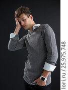 Купить «Depressed androgynous man posing hand on head», фото № 25975748, снято 15 декабря 2016 г. (c) Wavebreak Media / Фотобанк Лори