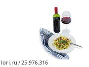 Купить «Pasta served in plate by wineglass», фото № 25976316, снято 21 октября 2016 г. (c) Wavebreak Media / Фотобанк Лори