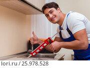 Купить «Young repairman working at the kitchen», фото № 25978528, снято 1 ноября 2016 г. (c) Elnur / Фотобанк Лори