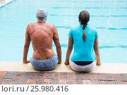 Купить «Female coach and senior man sitting at poolside», фото № 25980416, снято 12 декабря 2016 г. (c) Wavebreak Media / Фотобанк Лори