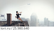 Купить «Woman banker on house top . Mixed media», фото № 25980640, снято 24 мая 2015 г. (c) Sergey Nivens / Фотобанк Лори