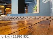 Купить «Table at empty cafe shop», фото № 25995832, снято 27 января 2017 г. (c) Wavebreak Media / Фотобанк Лори