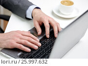 close up of male hands with laptop and coffee cup. Стоковое фото, фотограф Syda Productions / Фотобанк Лори