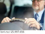 Купить «senior businessman hands driving car», фото № 25997656, снято 16 июля 2016 г. (c) Syda Productions / Фотобанк Лори