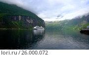 Купить «Cruise Liners On Geiranger fjord, Norway», видеоролик № 26000072, снято 29 марта 2017 г. (c) Андрей Армягов / Фотобанк Лори