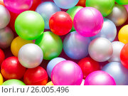 Купить «Multicolored plastic balls», фото № 26005496, снято 3 апреля 2017 г. (c) Олег Шеломенцев / Фотобанк Лори