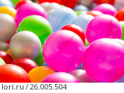Купить «Multicolored plastic balls», фото № 26005504, снято 3 апреля 2017 г. (c) Олег Шеломенцев / Фотобанк Лори