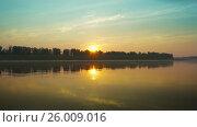 Купить «Landscape with sunrise over big river, 4k», видеоролик № 26009016, снято 5 апреля 2017 г. (c) Михаил Коханчиков / Фотобанк Лори