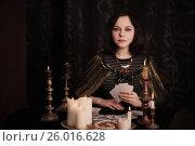 Купить «Young woman with divination cards in room», фото № 26016628, снято 5 марта 2017 г. (c) Майя Крученкова / Фотобанк Лори